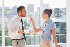 Business team having a heated argument. In a bright office Royalty Free Stock Photography