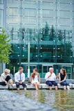 Business team having meeting with feet in water Royalty Free Stock Image