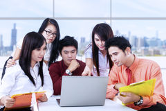 Business team meeting with laptop in office Stock Photography