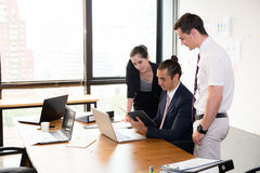 Business team having a meeting using laptop during a meeting. Stock Images