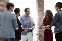 Business: Team having a serious argument. One colleague being the mediator royalty free stock photo
