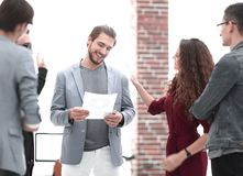 Business: Team having a serious argument. One colleague being the mediator stock image