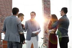 Business: Team having a serious argument. One colleague being the mediator stock photography
