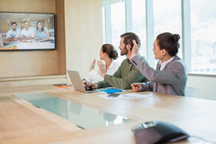 Business team having video conference with another business team royalty free stock images
