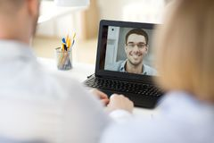 Business team having video conference at office royalty free stock photography