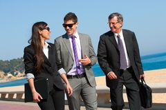 Business team having a walk outdoors. Royalty Free Stock Photos