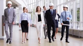 Business team in helmets with blueprint at office 60 stock footage