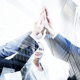 Business team high five, double exposure with modern finance arc. Hitecture background Stock Photography