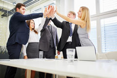 Business team high fives each other Royalty Free Stock Photos