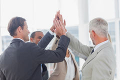 Business team high fiving Royalty Free Stock Photography