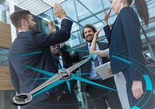 Business team high fiving and compass graphic Royalty Free Stock Photos