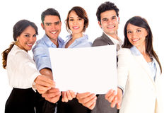 Business team holding a banner Stock Photo