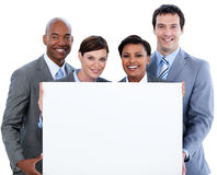 Business team holding a big white card Royalty Free Stock Image
