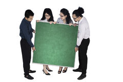 Business team holding blank chalkboard Royalty Free Stock Photo