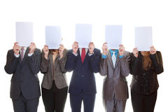 Business team holding blank papers. Business team holding blank papers with copy space Stock Photo