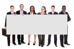 Business team holding blank placard Stock Photo