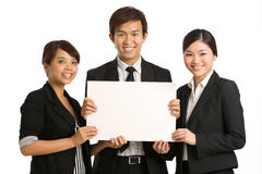 Business team holding a blank sign Stock Photos
