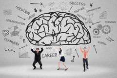 Business team holding a brain 1 Royalty Free Stock Photo