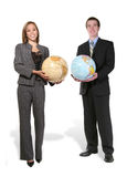 Business Team Holding Globes. A business team holding up globes of the earth stock photos