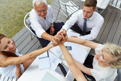 Business team holding hands for motivation royalty free stock photography