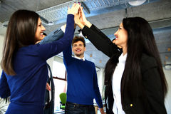 Business team is holding hands together. Raising one hand up Royalty Free Stock Photos