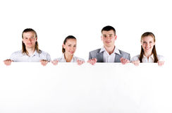 Business team holding a large blank Royalty Free Stock Image