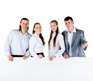 Business team holding a large blank Stock Photo