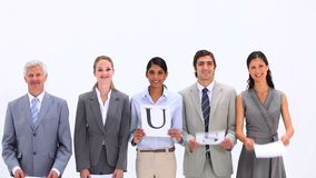 Business team holding letters that make the word TRUST Royalty Free Stock Image