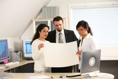 Business team holding paper Royalty Free Stock Image