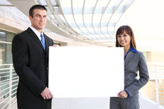 Free Business Team Holding Sign Royalty Free Stock Photos - 10029018