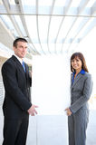 Business Team Holding Sign Stock Images