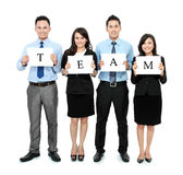 Business team holding small blank paper Royalty Free Stock Image