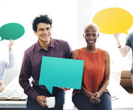 Business Team Holding Speech Bubble Sign Concept Stock Image