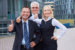Business team holding thumbs up Royalty Free Stock Images
