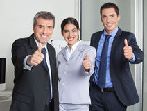 Business team holding thumbs up Stock Images