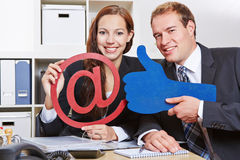 Business team holding thumbs up for Royalty Free Stock Image