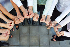 Business team holding thumbs up Stock Photography
