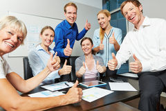 Business team holding thumbs up in office Royalty Free Stock Photos