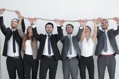 Business team is holding on to a strong rope. Photo with copy space stock photo