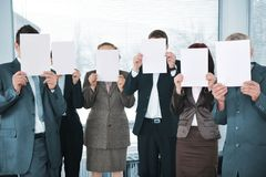 Business team holding white papers Royalty Free Stock Photo