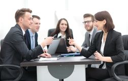 Business team holds a brainstorm. Brainstorming. professional business team at the briefing royalty free stock photo