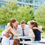 Business team hugging for motivation. In a meeting outdoors Royalty Free Stock Photography