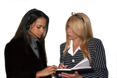 Business team II. Business team women with glasses and headset working Stock Photography