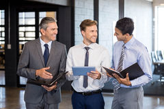 Business team interact using digital tablet and organizer Stock Image