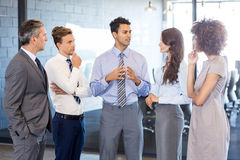 Business team interacting in office Royalty Free Stock Photography