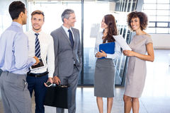 Business team interacting in office Royalty Free Stock Photos