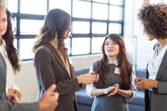 Business team interacting in office Stock Photo