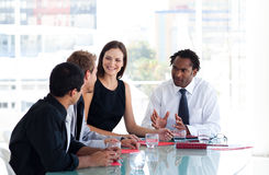 Business Team Interacting To Each Other In Office Royalty Free Stock Photos