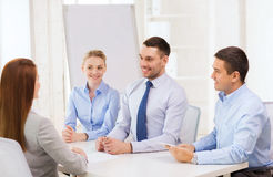 Business team interviewing applicant in office Stock Images