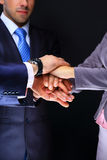 Business team joining hands. On a black background Stock Photo